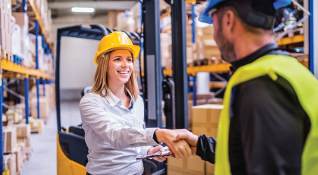 End-to-End Services -People in Warehouse Shaking Hands